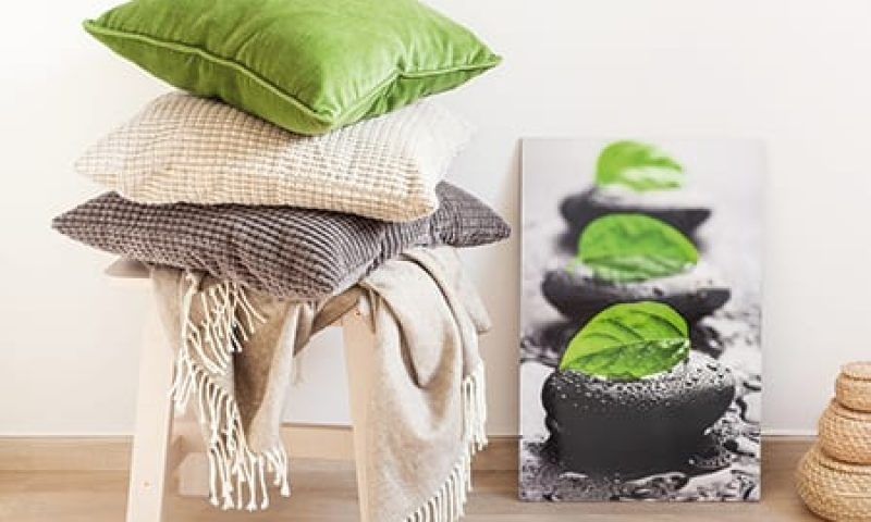 gray and green cushions cozy home interior